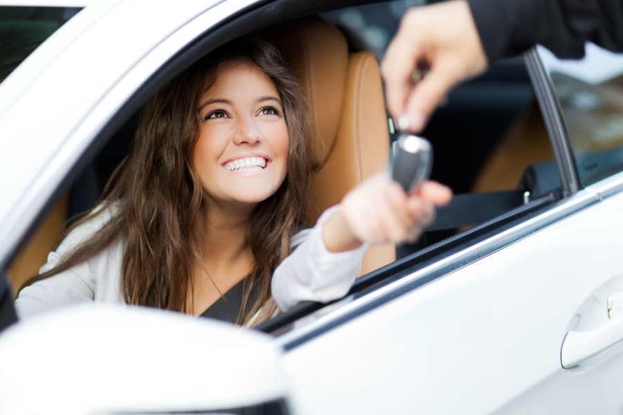 woman in new car