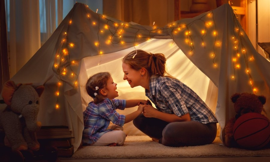 mother and daughter in tent