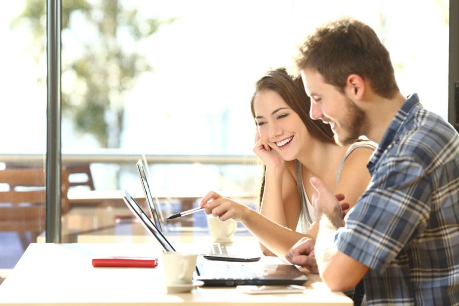 young couple on laptops