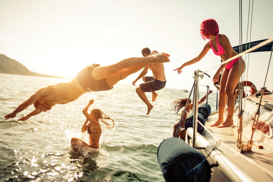 people jumping off a boat
